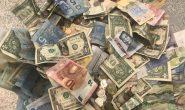 Dollar under pressure as economic uncertainties linger